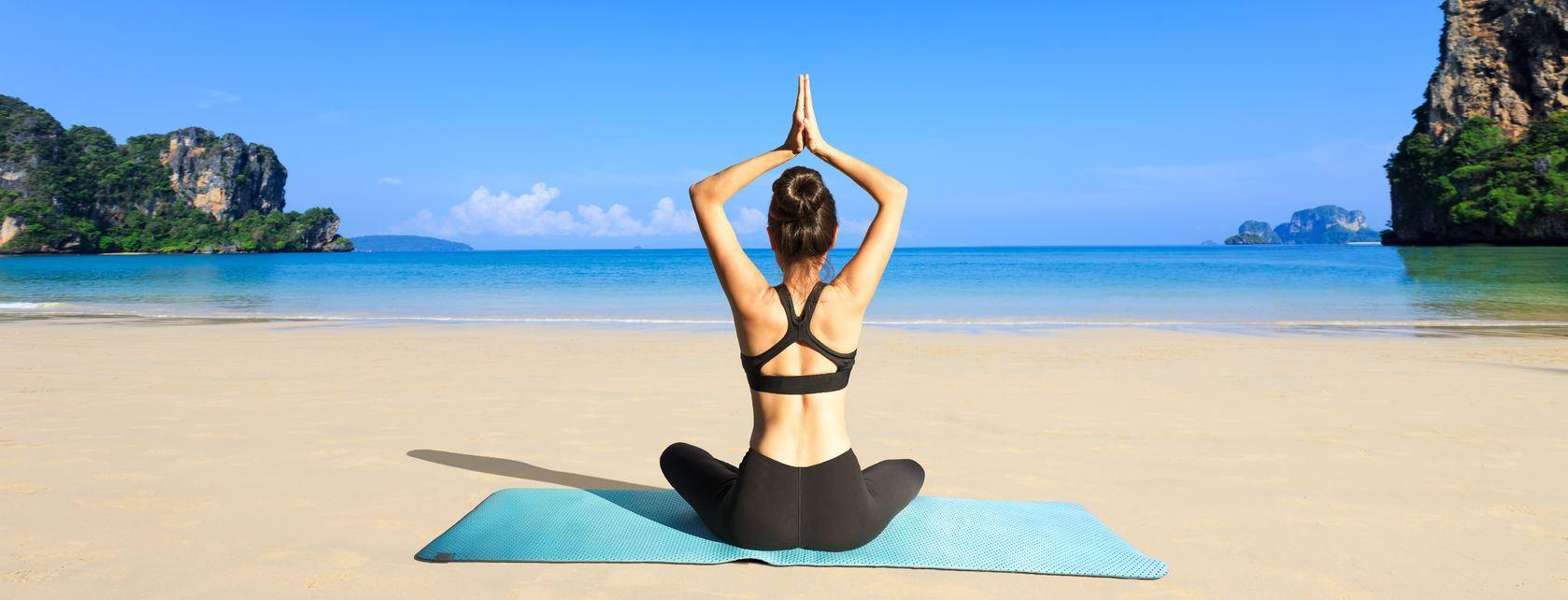 27874078 - yoga woman on sea coast