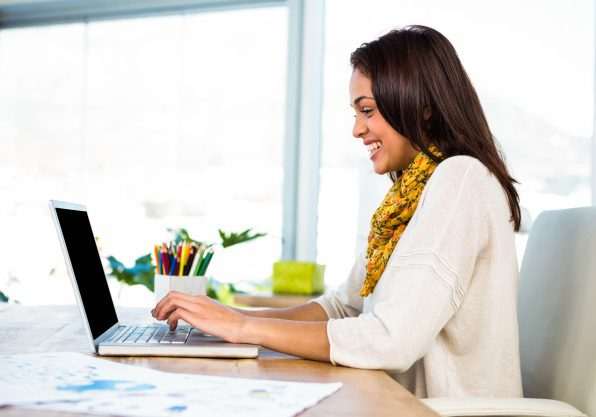 young-girl-uses-his-computer-office_107420-35
